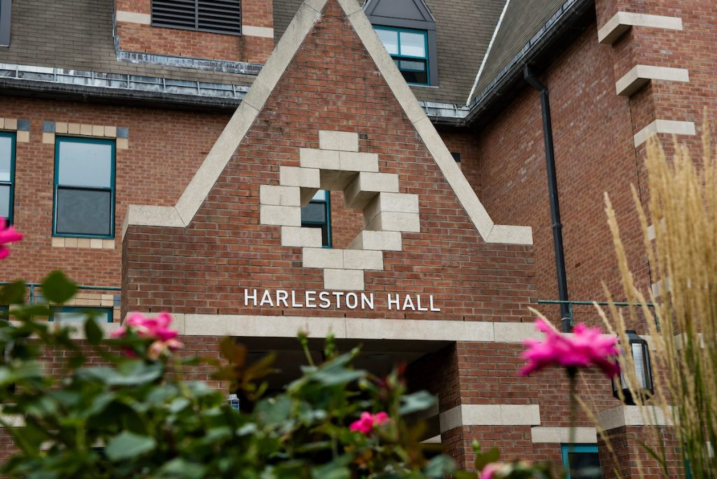 """09/23/2016 - Medford/Somerville, Mass. - Signage has been changed to read, """"Harleston Hall"""" on September 23, 2016. South Hall was dedicated to Dr. Bernard W. Harleston, H98, a psychologist, and the first African American hired to a tenure-track position at Tufts who was also the first African American president of the City College of New York. He is a trustee emeritus of Tufts, having served on the board from 2002 to 2007. (Alonso Nichols/Tufts University)"""
